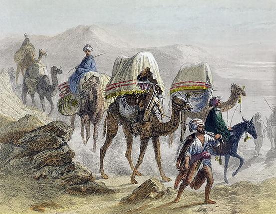 کاروان تجار سوار بر شترها در حال عبور